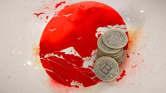 Japanische Flagge und Bitcoin Münzen